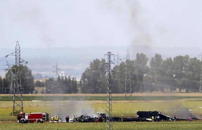 The remains of Airbus A400M are seen after crashing in a field near the Andalusian capital of Seville